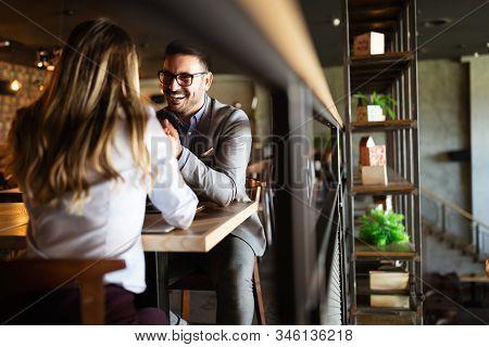 Happy Romantic Smiling People Having Date In Restaurant. Couple In Love.