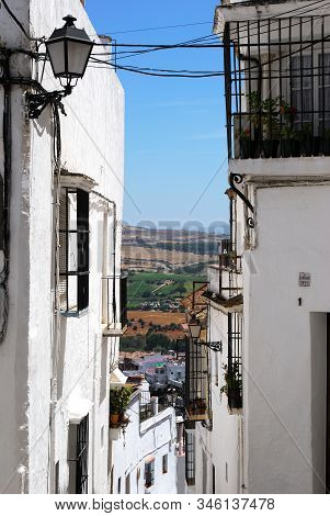 Arcos De La Frontera, Spain - August 1, 2008 - View Down A Narrow Old Town Street Towards The Countr