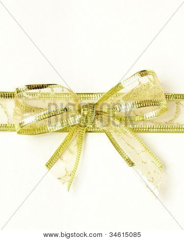 golden ribbon tied bow for holiday background