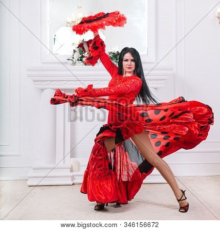 Attractive Female Dancer With Fan Performing Flamenco