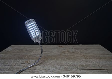 Led Usb Lights On A Wooden Background In Black