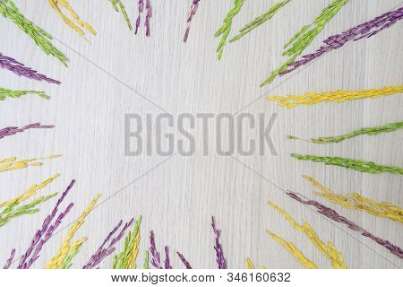 Dehydrated Rice Grains On A Wooden Floor