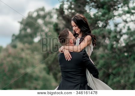 In Full Growth. Bride And Groom Looking At Each Other Tenderly