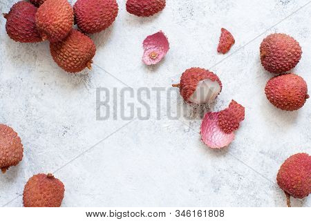 Fresh Litchi Fruits On A White Table Top View