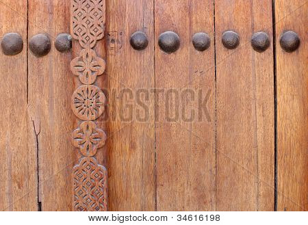 Bolts and beautiful design on ancient door in Riffa fort Bahrain