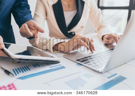 Woman Using Laptop Computer Working On New Project Idea At His Desk In The Office Late, Young Female
