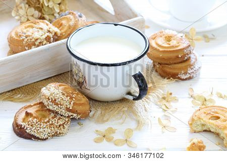 Cookies With Milk On A Wooden Table. Milk With Cookies On A White Wooden Table