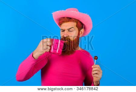 Cowboy With Cup. Portrait Of Cowboy. Lollipop. Cowboy Drinking. American Bandit. American West. West