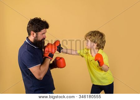 Little Kid Boxing With His Coach. Dad And His Son In Boxing Gloves. Child And Instructor Training In