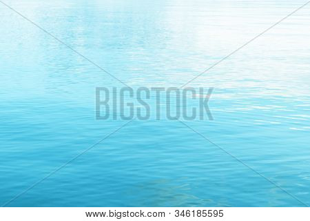 Tranquil Surface Texture Of The Ocean. Water Ripples. Blue Sea Water In Calm. Crystal Clear Sea Wate