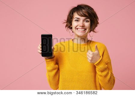 Funny Young Brunette Woman Girl In Yellow Sweater Posing Isolated On Pastel Pink Background. People