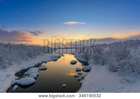 Winter Sunset Over The Teriberka River Above The Arctic Circle In The Kola Peninsula, Near Murmansk,