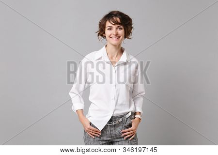 Smiling Successful Confident Young Business Woman In White Shirt Posing Isolated On Grey Background