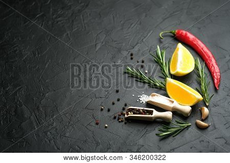 Selection Of Spices, Herbs And Lemon. Ingredients For Cooking. Food Background On Dark Stone Table.