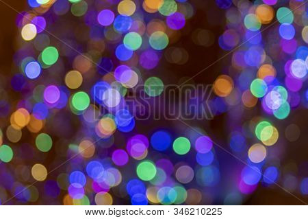 Holiday Bubbles Lights Bokeh Background. Abstract Glitter Lights Blue And Multicolored, De-focused.