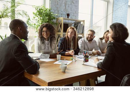 Happy Emotions. Group Of Young Business Professionals Having A Meeting. Diverse Group Of Coworkers D