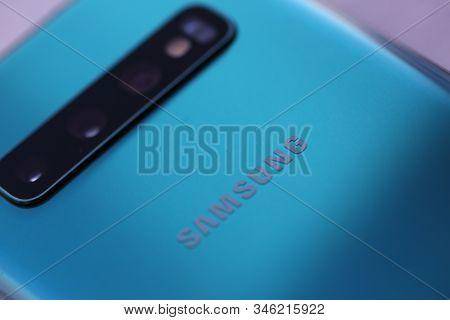 Minsk, Belarus - March 8, 2019 : Smartphone Samsung Galaxy S 10 Aquamarine Color Illustrative Editor