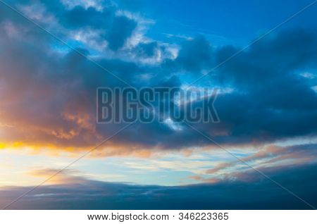 Dramatic blue sky background. Picturesque colorful clouds lit by sunlight. Vast sky landscape panoramic scene - colorful sky view in bright tones, picturesque sky landscape