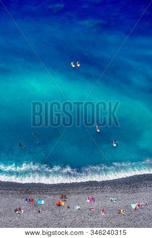 Tropical Beach With Colorful Beach Towls, People, Divers And Surfers - Top Down Aerial View