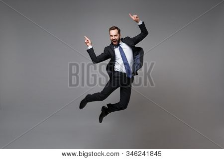 Happy Young Business Man In Classic Black Suit Shirt Tie Posing Isolated On Grey Background. Achieve