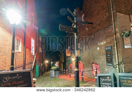 Rye England - August 19 2019; Conduit Hill Lane With Bar Signage And Night Lights With Direction Sig
