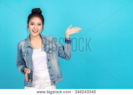 Happy Asian Woman Feeling Happiness And Standing Hold Smartphone Other Hand Open On Blue Background.