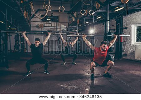 Barbell Group Workout, Group Of Three Young Friends Fit Muscular Fitness Guys Having Fun By Hard Cor