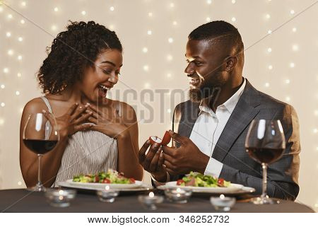 Marriage Proposal At Valentines Day. Black Man Making Marriage Proposal To His Surprised Beautiful W