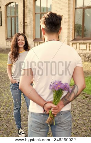Love Story. Flowers Delivery Concept. Selective Focus. Couple In Love. Man Prepared Surprise Bouquet