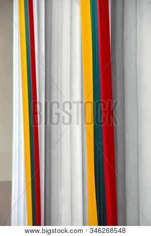 The Column Of The Building Is Decorated With Lithuanian Tricolor: Yellow, Red, Green. View In The Ca