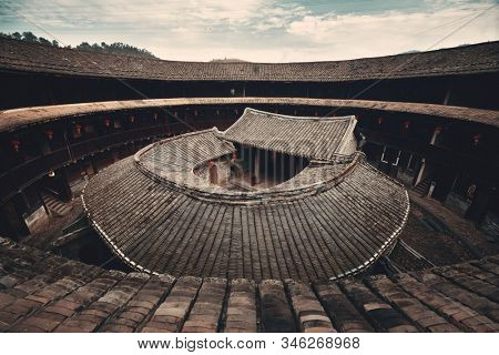 FUJIAN, CHINA – MARCH 2, 2018: Zhenfu Lou is a typical Tulou building. Tulou is the unique traditional rural dwelling of Hakka.