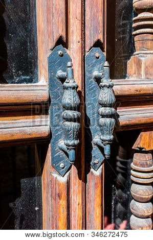 Old Metal Handle With The Woodworm Holes On The Door