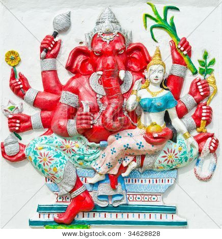 God of success 25 of 32 posture. Indian style or Hindu God Ganesha avatar image in stucco low relief technique with vivid colorWat Samarn ChachoengsaoThailand. poster