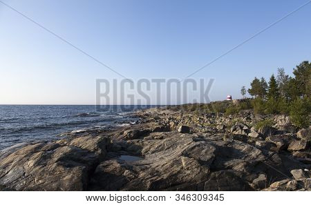 View Of The Shore Of The Baltic Sea Up North. Cliff, Rocks And Islands. Barren. Navigation Mark In T
