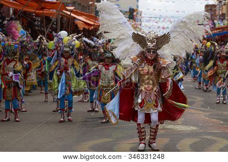 Oruro, Bolivia - February 26, 2017: Diablada Dancers In Ornate Costumes Parade Through The Mining Ci