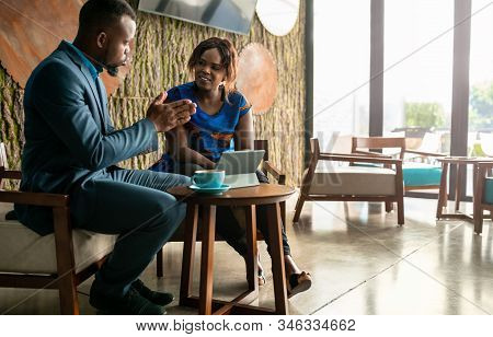 Wide Shot Business Meeting Consultation By Black African Financial Adviser With Flair Copyspace