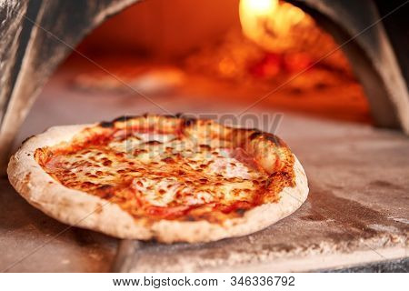 Baked Tasty Margherita Pizza In Traditional Wood Oven In Naples Restaurant, Italy. Original Neapolit