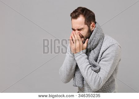 Young Man In Gray Sweater, Scarf Posing Isolated On Grey Background. Healthy Lifestyle, Ill Sick Dis