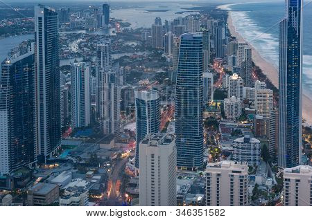 Aerial Cityscape With Futuristic Skyscrapers At Dusk. Modern City Skyline View. Gold Coast, Australi