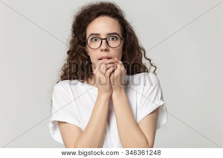 Young Stressed Fearful Woman In Eyewear Feeling Awe.