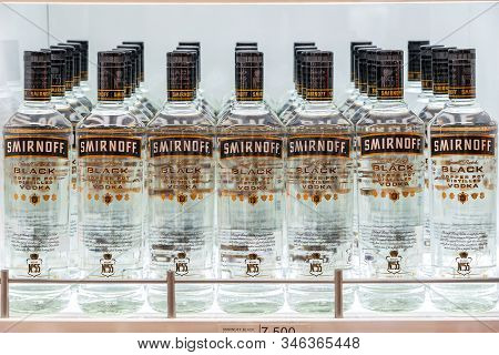 Muscat, Oman - January 19, 2020 : Bottles Of Smirnoff Vodka On A Shelf In Duty Free Shop Airport. Bl