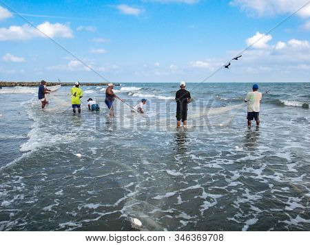 Cartagena De Indias, Colombia - August 04, 2014: Local Fishermen Working Out With Fishing Nets Near