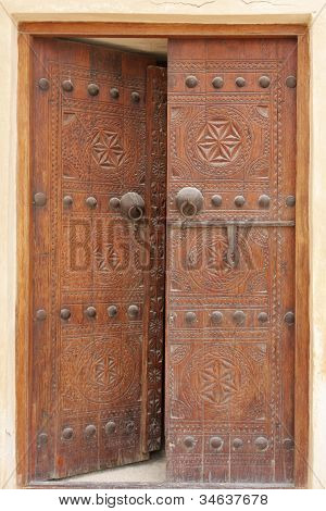 Ancient carved door with bolts in Riffa fort Bahrain