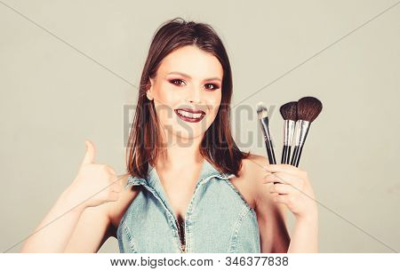 Skin Care. Looking Good And Feeling Confident. Woman Applying Makeup Brush. Professional Makeup Supp