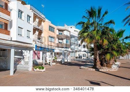 ALCOSSEBRE, SPAIN - JANUARY 11, 2020: A view of the Passeig de Vista Alegre promenade, in the seafront of Alcossebre, in the Costa del Azahar, Spain, in a winter day