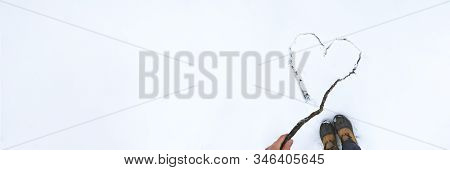 Female Hand Draw Heart By Stick On White Snow. Banner Of Beautiful Winter Background For Valentines