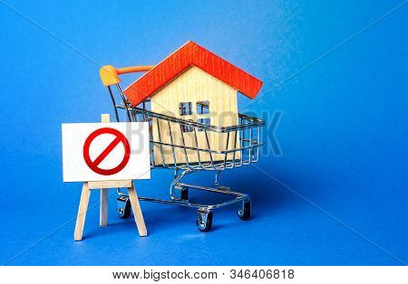 House In A Shopping Cart And An Easel With A Red Prohibition Sign No. Inaccessibility, Lack Of Housi