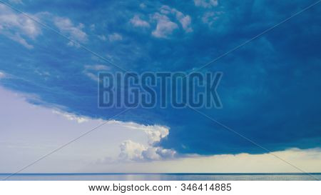 Beautiful Blue Sea Sky Or Ocean Water And Scenic Puffy Clouds Epic Peaceful Background. Panoramic Dr