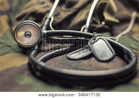 Stethoscope Lies On The Uniform Of A Us Soldier. The Concept Of Health Care, Military Insurance, Sta