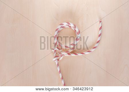 Round Turn And Two Half Hitches Ship Knot On Wooden Background, Boating Knot